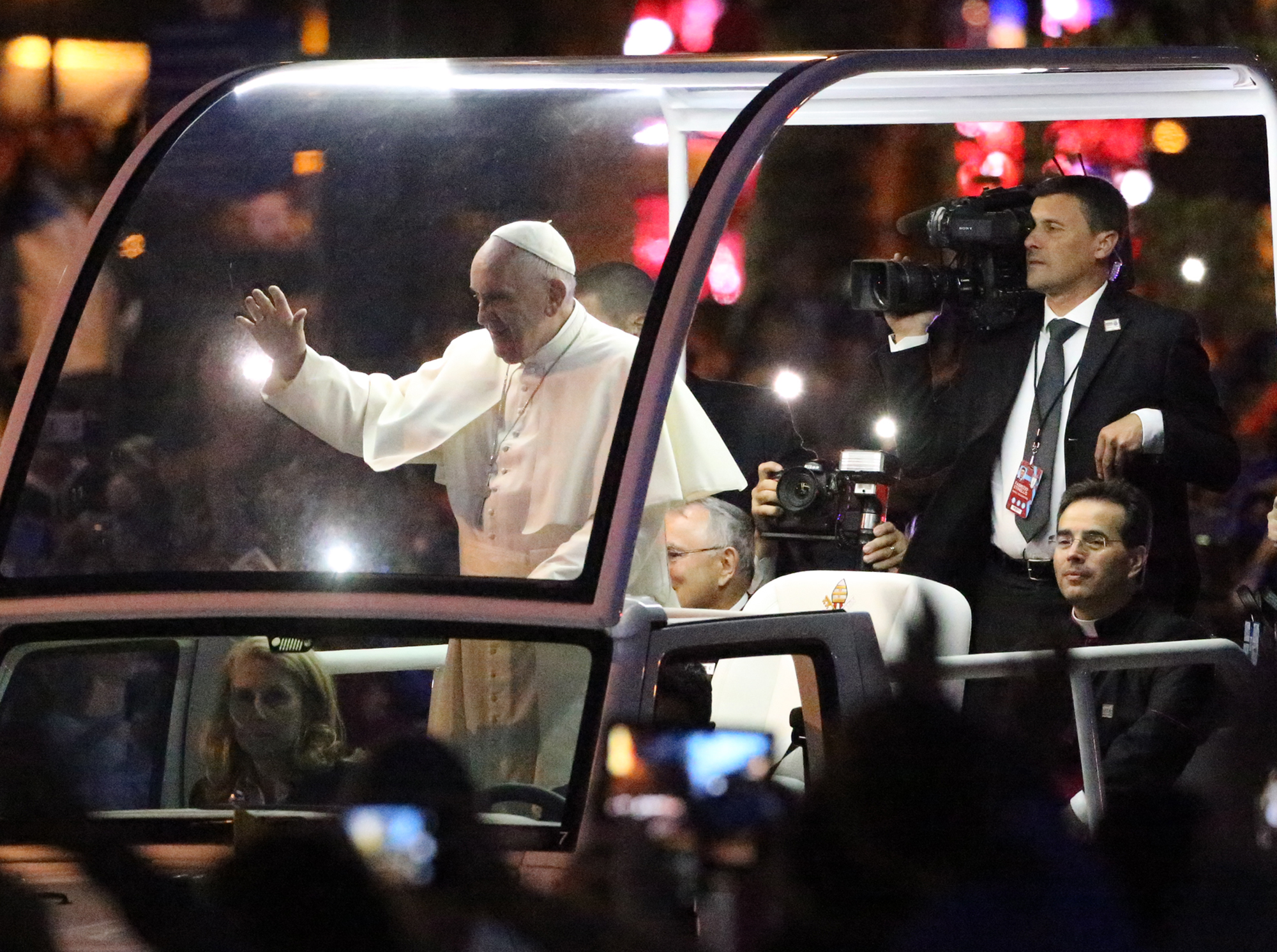 Pope Francis waves to throngs of people lining the roadway during he visit to Philadelphia, PA Sept. 19, 2015